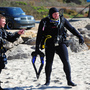 Thumb_scuba_diver_geared_up_on_the_beach