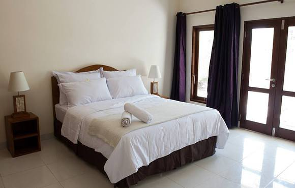 double bed at blue marine dive resort gili air