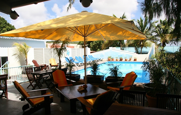 terrace next to pool at caribbean club bonaire