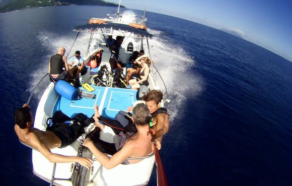 scuba divers on boat Seychelles